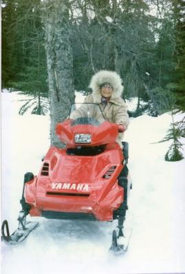 Ruby Leppke Gaede driving a snow machine on the Gaede-80 Homestead, Soldotna, Alaska