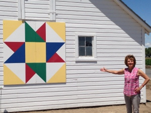 Naomi by one of her favorite barn quilts.