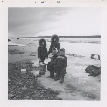 Ruby and children making icecream on Yukon 1959